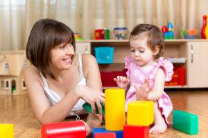 teacher teaching an infant