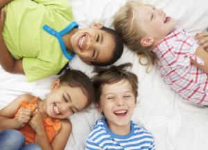 4 kids laughing