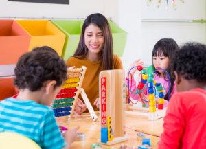 asian teacher with kids